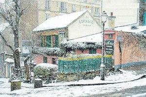 Au Lapin Agile on a snowy day. (Photo courtesy of Au Lapin Agile)